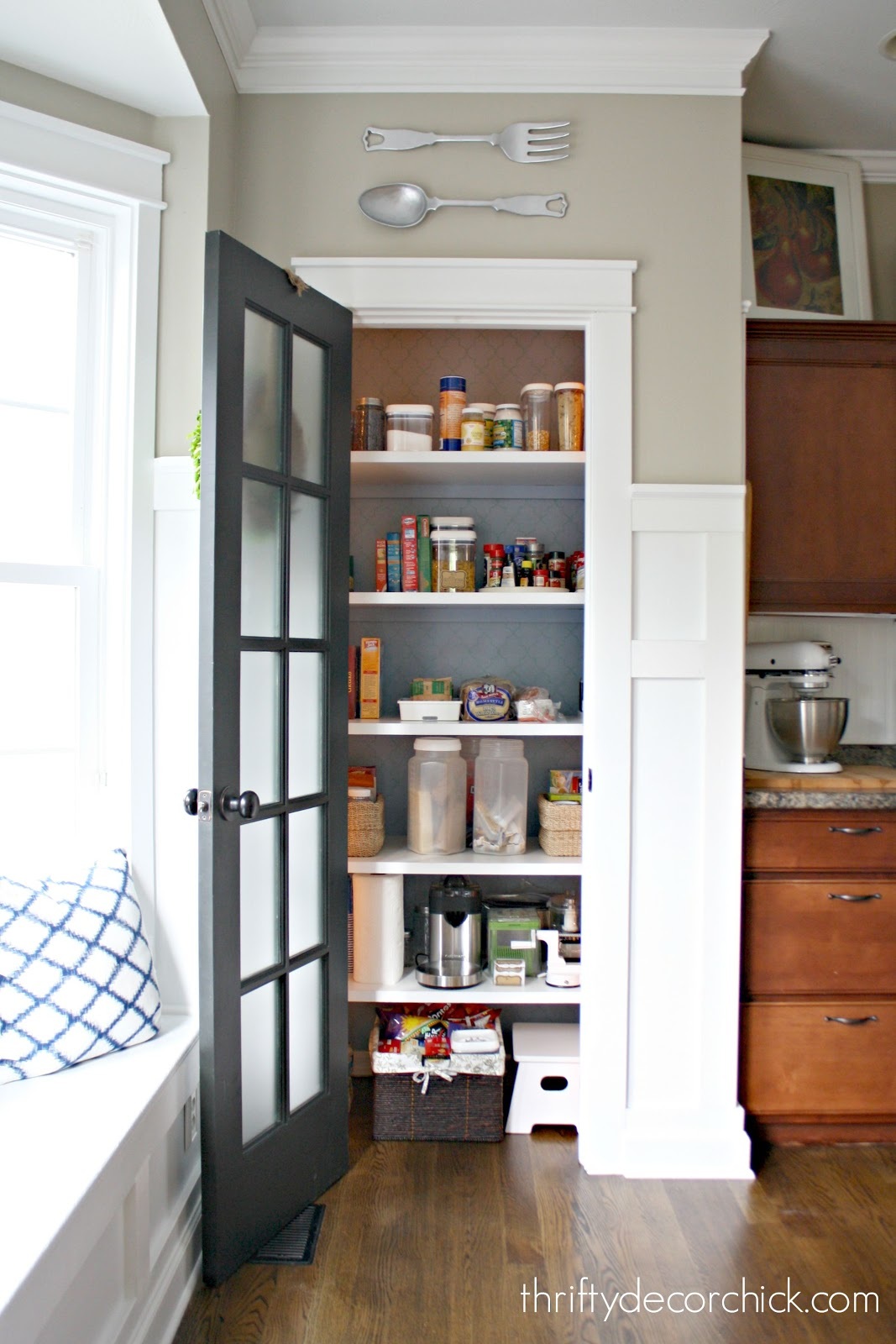 pantry with glass door