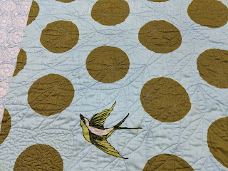 The photo shows how orange peel quilting designs appears on the quilt back