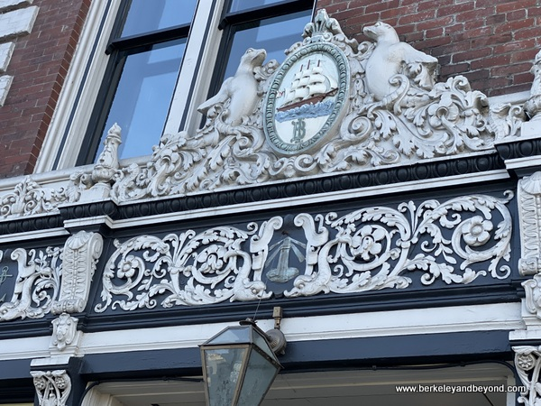 ornate Bank of Italy plaque on Boulevard restaurant building on Commonwealth Club Waterfront tour in San Francisco, California
