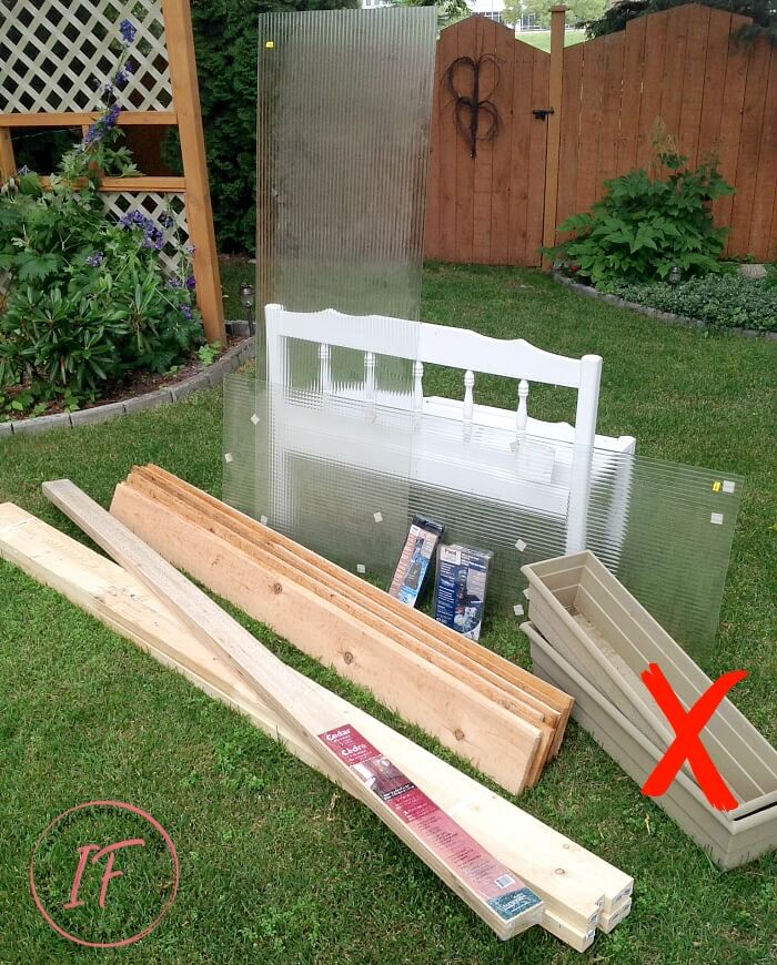 An amazing DIY Outdoor Water Feature for under $300 for a backyard deck or patio using recycled tempered glass. The outdoor fountain is also illuminated at night with solar flood lights. A budget-friendly water feature plus privacy screen for those who know how to rock power tools by Interior Frugalista