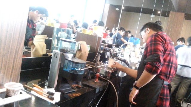 Baristas in action- slow brewing using methods such as Siphon, Chemex, Hario V60, Kalita, Aeropress.