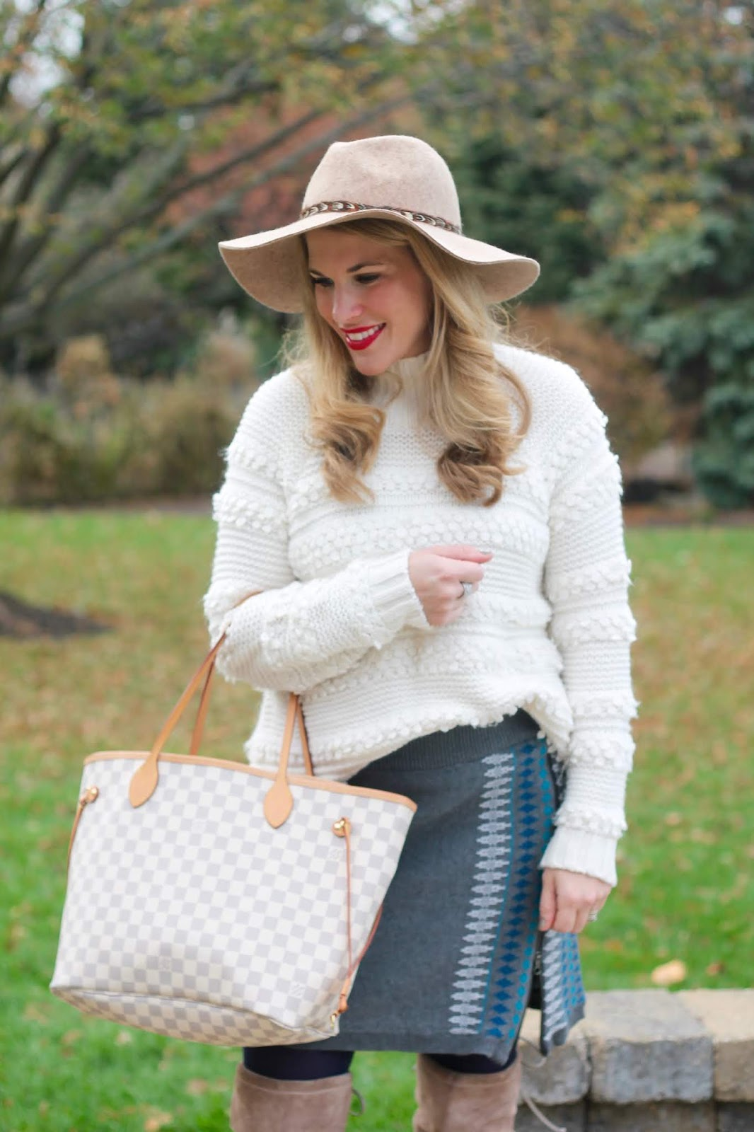 aventura grey knit skirt, over the knee taupe boots, white chunky knit sweater, LC azure neverfull, wide brim wool hat