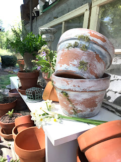 Adding layers to make your new pot look like a vintage inspired clay pot.