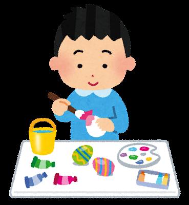 イースターのイラスト「卵に色を塗る男の子」
