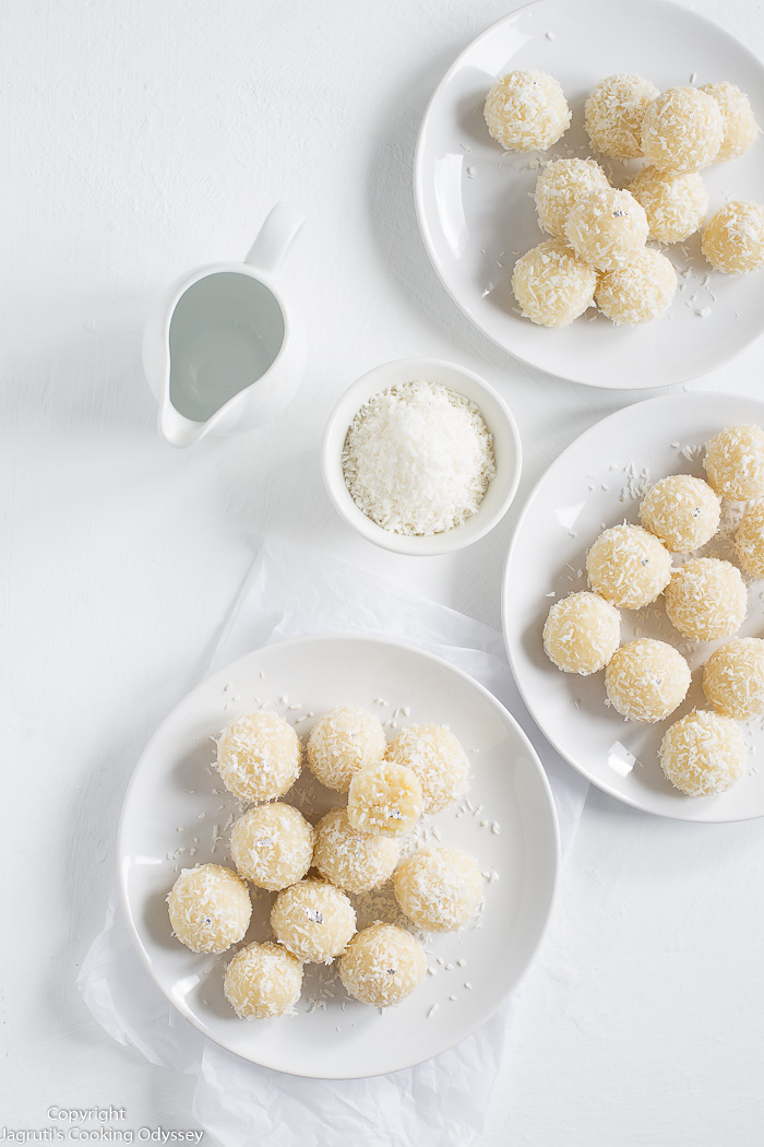 When I imagine coconut flavours, I think of delicate, fresh, creamy, and that's exactly what these Coconut Ladoos are. Coconut ladoos are hugely a popular Indian sweet recipe, made and enjoyed during Indian festivals such as Navratri, Diwali, Holi or Raksha Bandhan. These easy and sumptuous ladoos are made using only 3 ingredients - desiccated coconut, milk, and sugar.