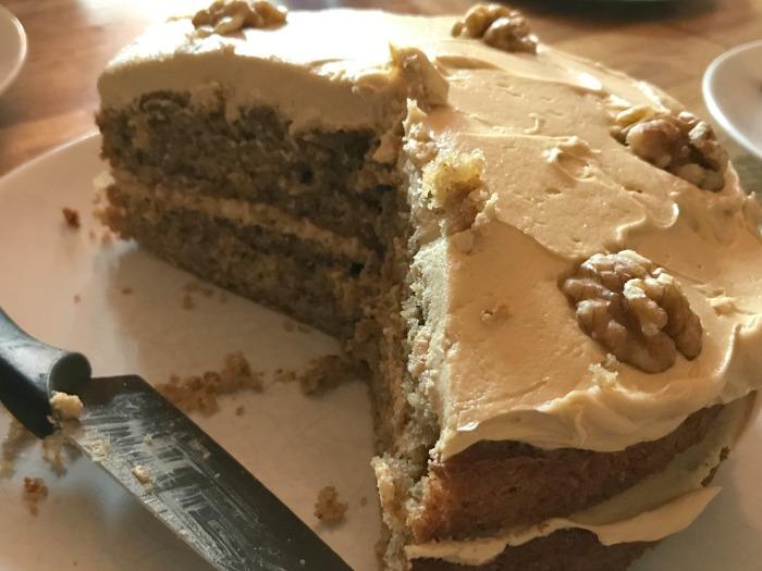 A half eaten coffee & walnut cake
