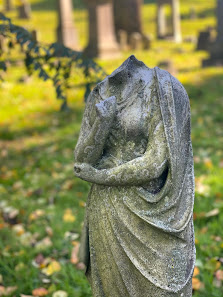 Headless gravestone sculpture of a woman in Greenwood Cemetery, Brooklyn