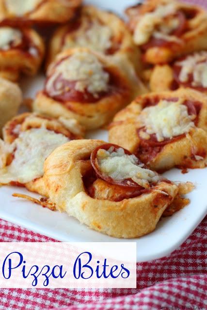 Little bites of pizza on a white platter