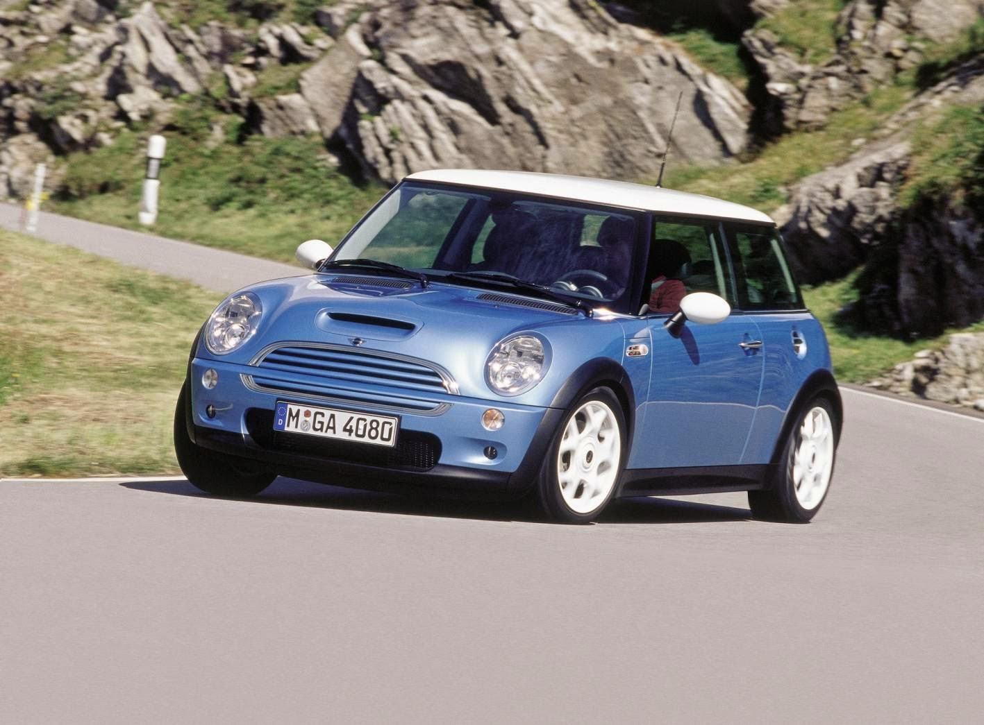 A Mini Cooper S in its natural habitat, a twisting mountain road