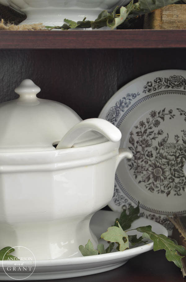 Stack ironstone dishes and tureens in a hutch for an interesting display.  |  www.andersonandgrant.com