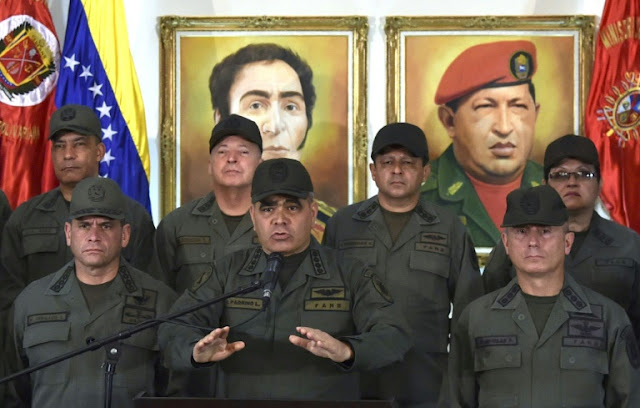 Venezuela's Defence Minister Vladimir Padrino(centre) says military will block US aid invasion