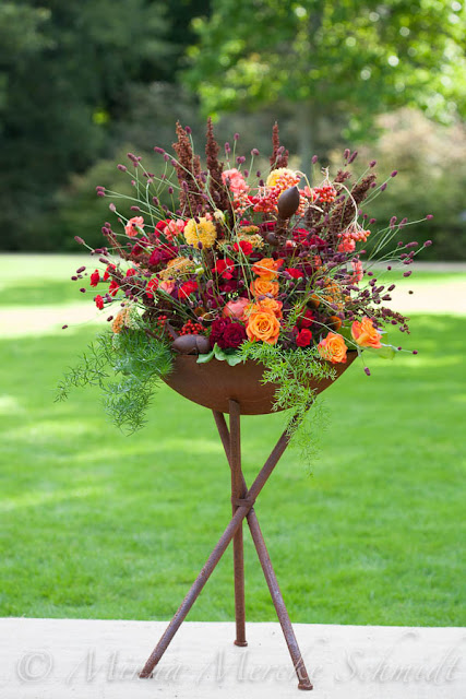 flower arrangement in red tones