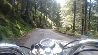 royal enfield riding on the left bank of Kullu towards Naggar town