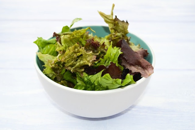 white bowl full of mixed salad leaves