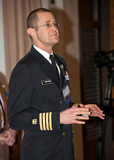 U.S. Public Health Service Capt. (Dr.) Joshua Morganstein, assistant director for USU's CSTS, gives a presentation on crisis leadership during a symposium. (Courtesy photo)