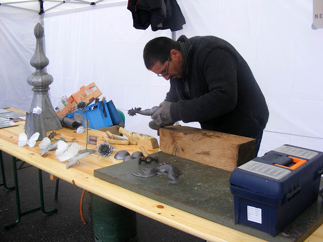 A metalworker at an arts fair, Indre et Loire, France. Photo by Loire Valley Time Travel.