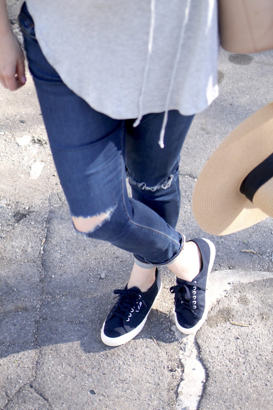bandana neck tie, navy superga sneakers, ripped jeans, lace up tee shirt, casual outfit, weekend look, sun hat, tote bag faux leather
