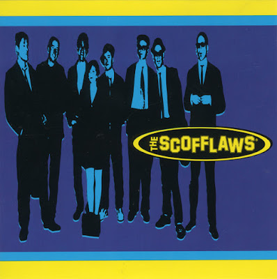 The band members are dressed in suits and the band's name is in the foreground.