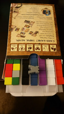 UTEK with an organizer that holds the cards below and slots for cubes above