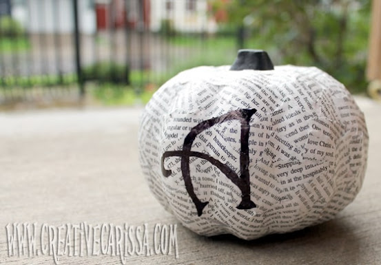 mod podge pumpkin covered in book pages