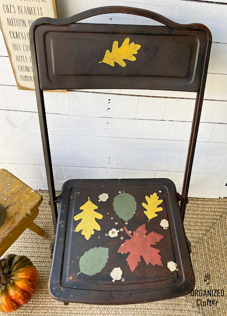 Photo of a fall leaf stenciled rusty chair.