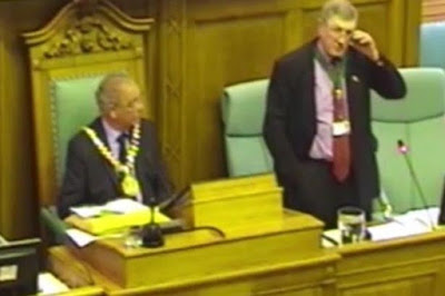Councillor looks mortified and gives awkward response after colleague proposes marriage during a public meeting (video)