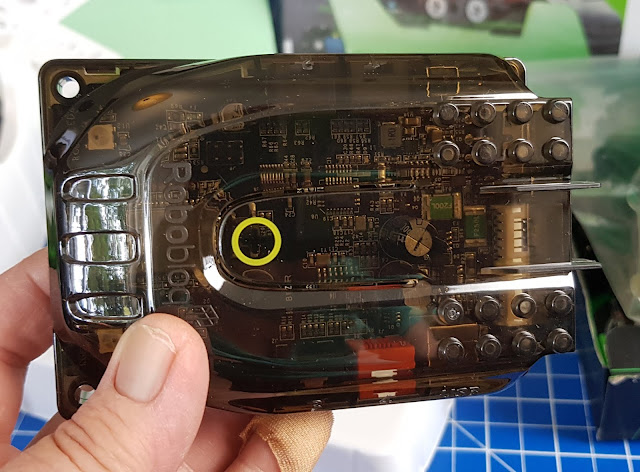 Robobloq Q-Scout brain is transparent plastic, showing wiring and circuitry