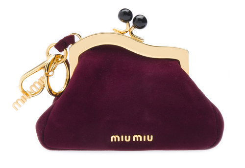 """ff66497b5974 ... the new Prada perfume """"Candy"""" with a complemental cosmetic bag and this season s  most important Miu Miu bags in a minature size for your key chain."""