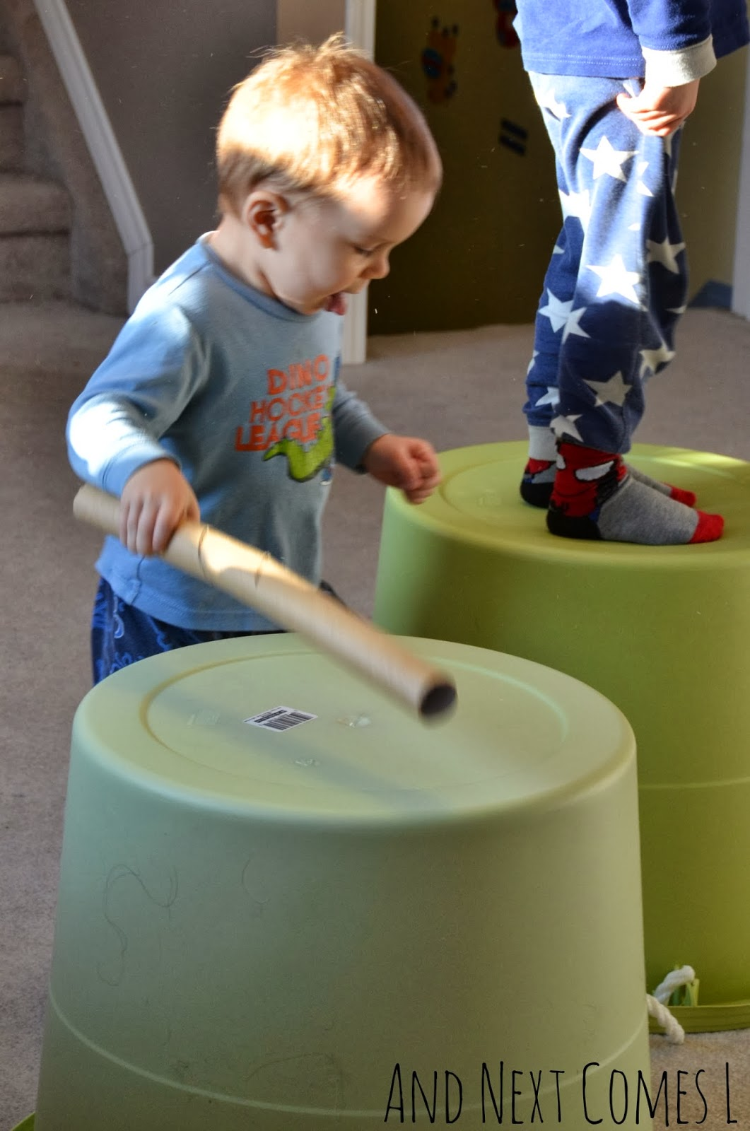 Drumming music activity for kids using buckets and cardboard tubes from And Next Comes L