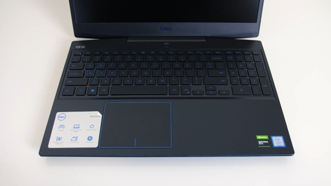 Smooth matte black plastic interior with blue accenting around the touchpad, keys, and everywhere on the laptop