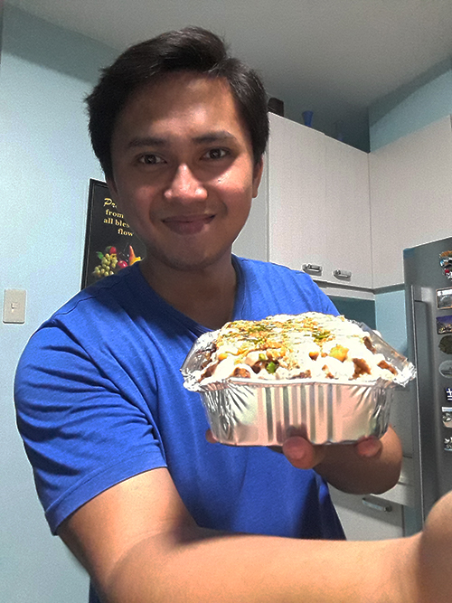 Michael holding the sisig