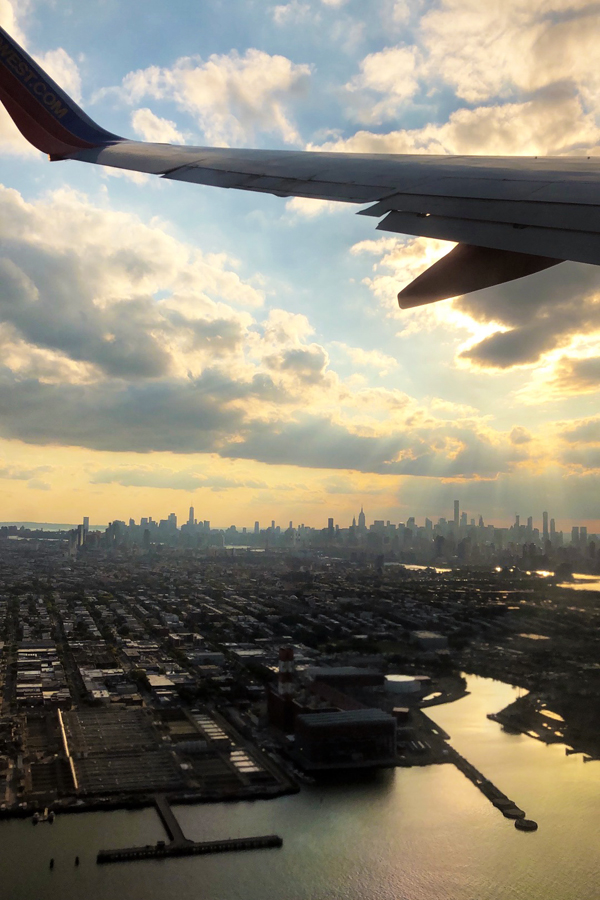 NYC Skyline seen from airplane at sunset
