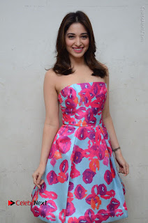 Actress Tamanna Latest Images in Floral Short Dress at Okkadochadu Movie Promotions  0076.JPG
