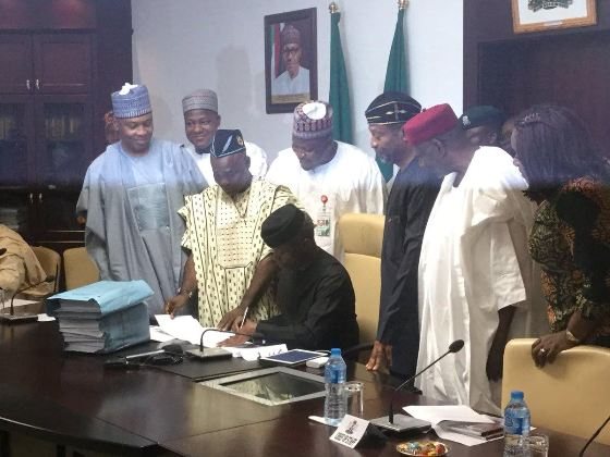 3 Acting President Yemi Osinbajo Signs The 2017 Budget Into Law (Photos)