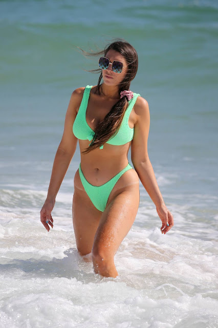 Victoria Larson – In a neon green bikini on the beach in Ft. Lauderdale