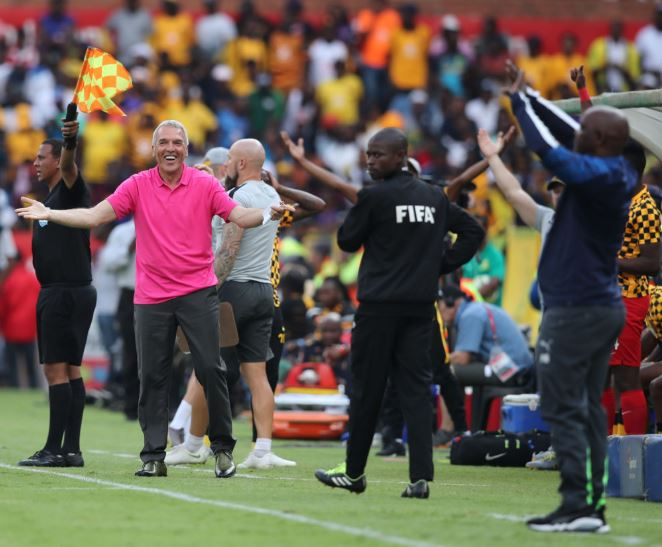 Ernst Middendorp and Pitso Mosimane on the touchline.