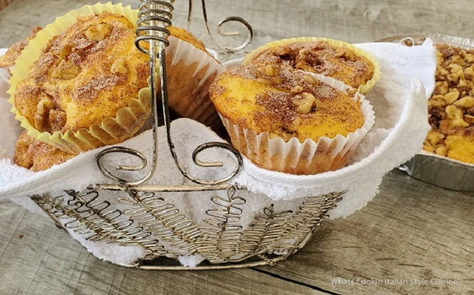 these are baked sour cream coffee cupcakes in a wire silver basket made from a doctored cake mix