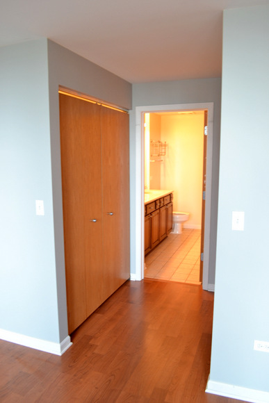Closets and view into the master bathroom.