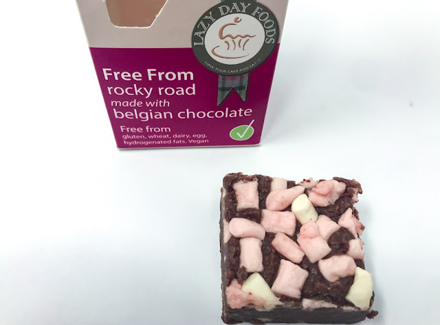 Lazy Food Days Free From rocky road box next to a piece of Rocky Road covered in mini vegan marshmallows