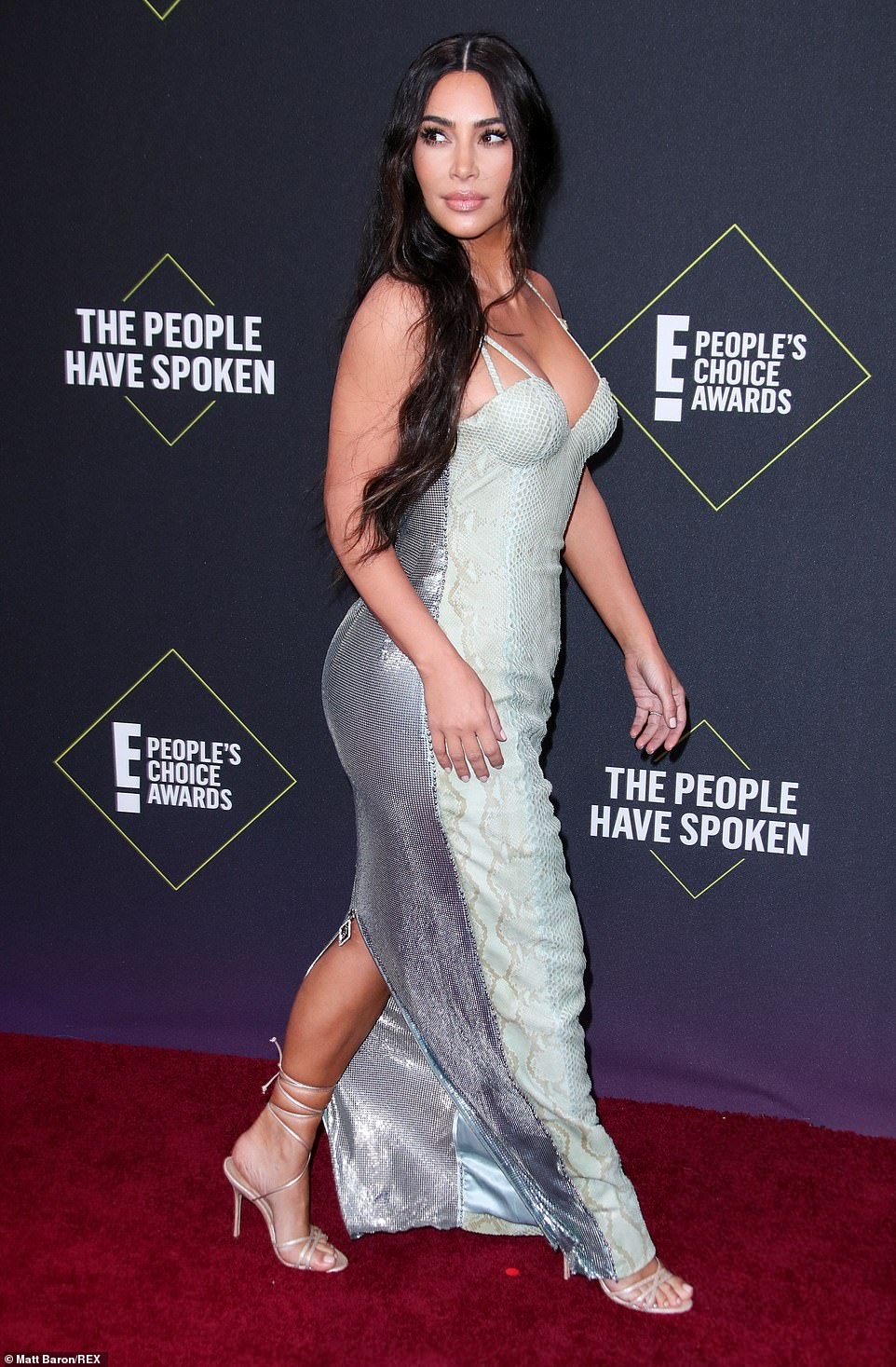 Kim Kardashian West embraces her curves in slinky snakeskin dress