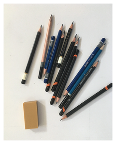 Some graphite pencils and an eraser