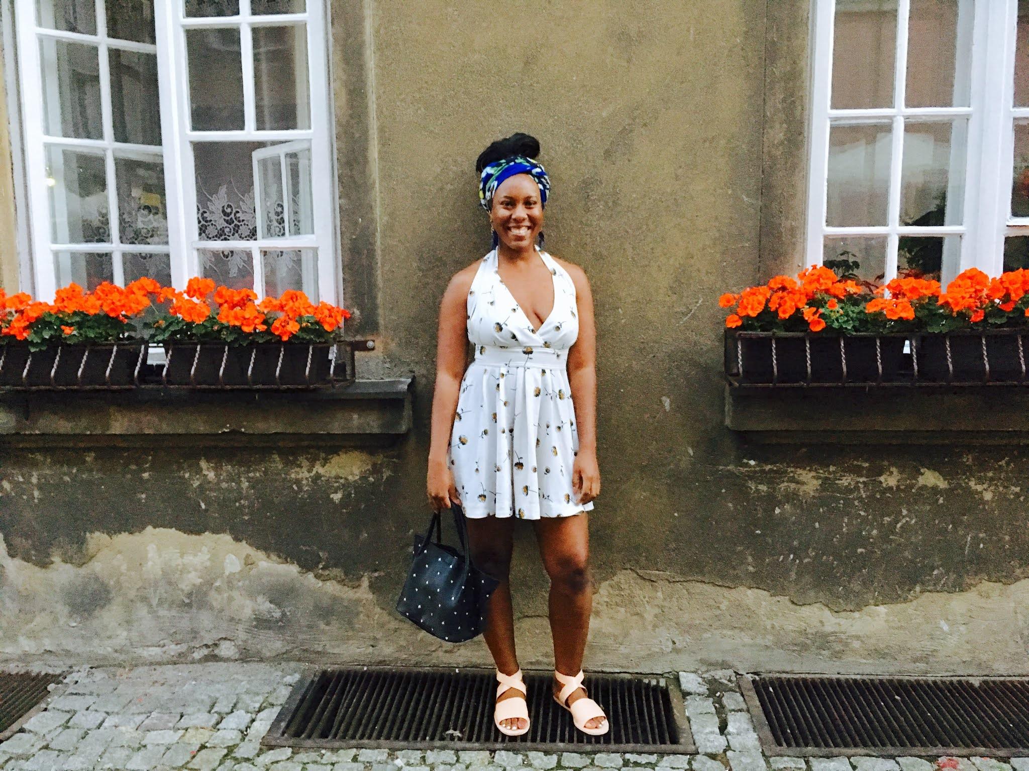 Letitia Elizabeth Europe Traveling Blogger Smiling in White Frock