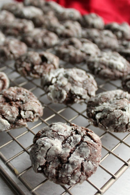 chocolate gooey butter cookies on wire cooling rack