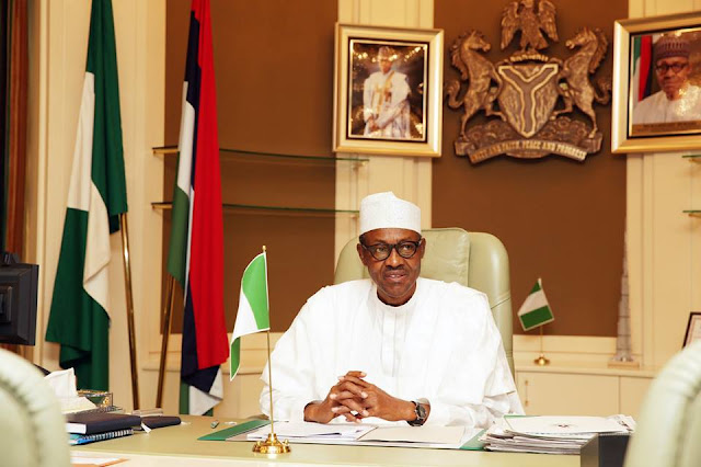 Picture of President Muhammadu Buhari in his office.