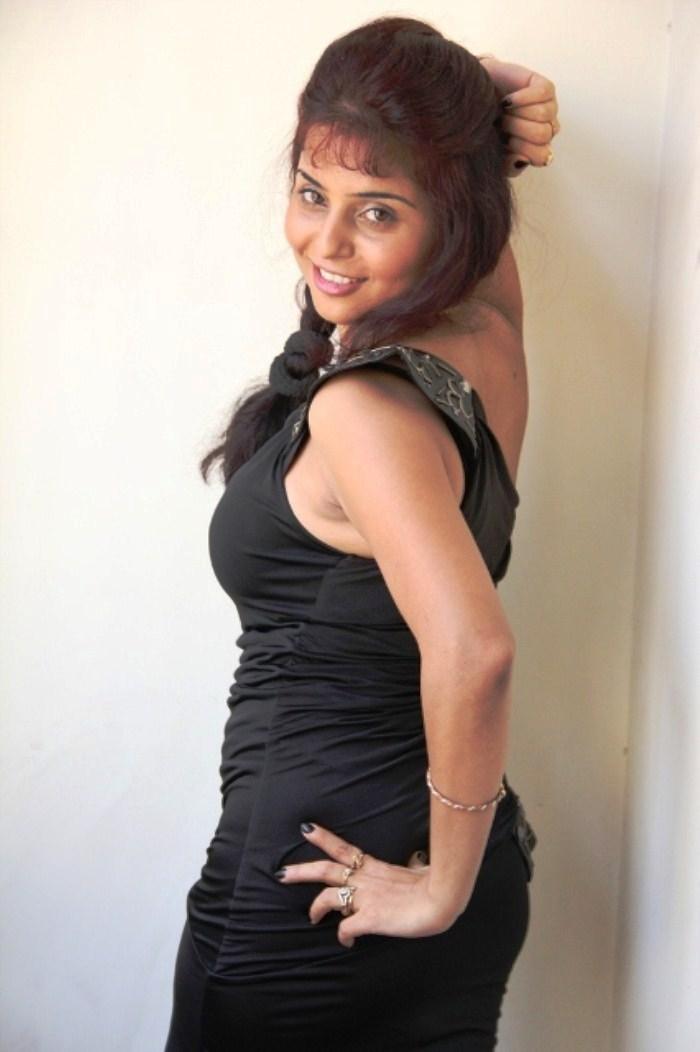 Prachi Adhikari Hot Sexy Photoshoot Black Tight Skirt -1079