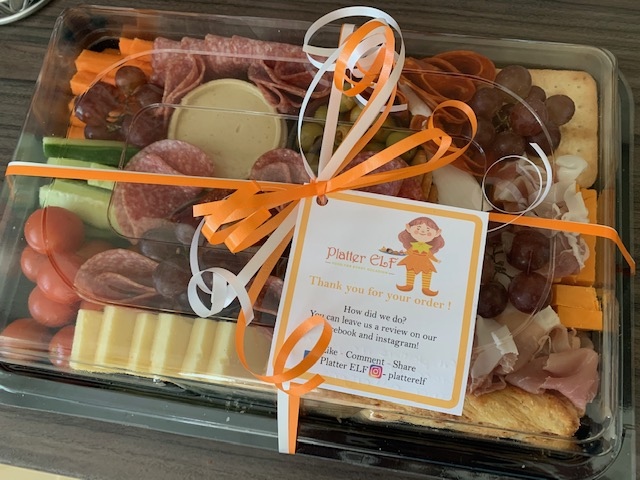 Sealed up platter containing meats, cheeses, crudites and antipasti