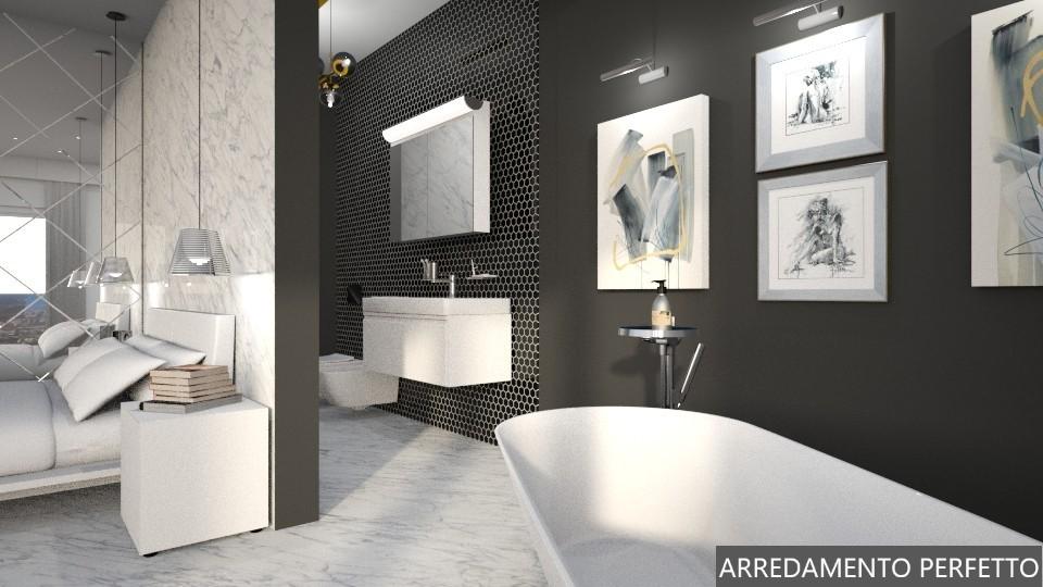 Bagno in camera con vasca a vista e specchio inciso per una soluzione di design