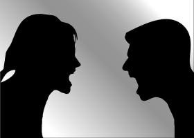 Silhouette picture of a couple arguing.