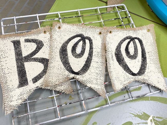 Burlap flags stenciled with BOO in black