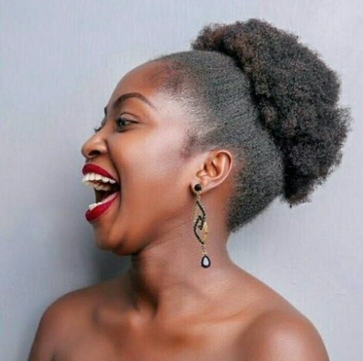 Happy woman with natural hair updo